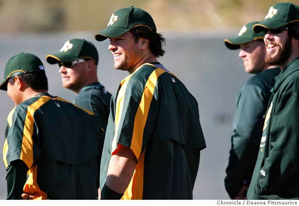 Mike Piazza (center) laughs with Dan Haren (right) as he arrives at spring training for the Oakland A's. The Oakland Athletics have a spring training workout at Papago Park. Photographed in Phoenix on 2/22/07. Chronicle Photo / Deanne Fitzmaurice