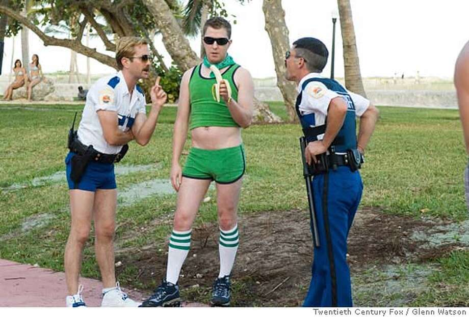 R-52 In Miami, Lt. Jim Dangle (Thomas Lennon, left) and Dep. Travis Junior (Robert Ben Garant) encounter an old �friend� from Reno: Terry (Nick Swardson). for movies23 Photo: Ho