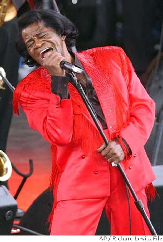 "** FILE **James Brown performs at the Olympic Flame concert in London on June 26, 2004. Brown, the ""Godfather of Soul"" and a legend in rap, rock and funk, has announced that he has prostate cancer. In a statement released to The Associated Press on Friday morning, Dec. 10, 2004, Brown, 71, said that he will undergo surgery for the ailment on Dec. 15. (AP Photo/Richard Lewis, File) Ran on: 12-11-2004  James Brown JUNE 26, 2004 FILE PHOTO Photo: RICHARD LEWIS"