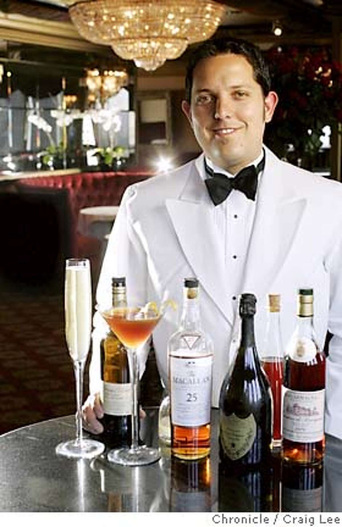 Photo of Harry Denton's Starlight Room bar manager, Jaques Bezuidenhout, with two of his newset drinks: Drinking the Stars (tall giant Champagne flute, far left), sells for $650, and the Heavenly Dram (in the martini glass) sells for $80. These drinks contain amazingly expensive ingredients like 24-year-old Macallan single-malt scotch and Dom Perignon Champagne, and people buy them. Event on 8/5/05 in San Francisco. Craig Lee / The Chronicle