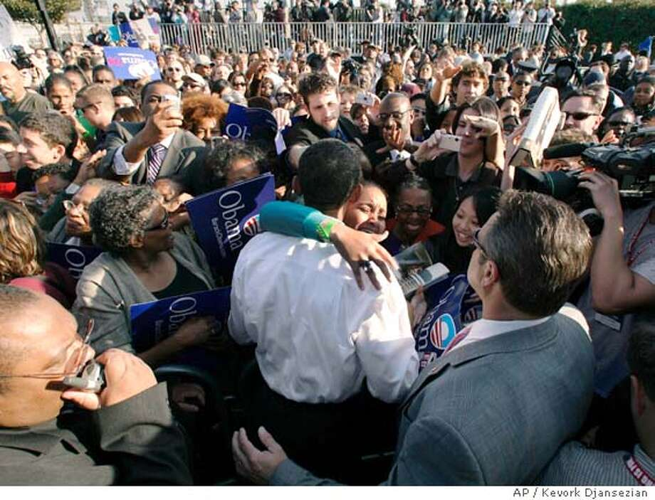 A supporter hugs Democratic presidential hopeful, Sen. Barack Obama, D-Ill., after his first campaign rally in Los Angeles Tuesday, Feb. 20, 2007. (AP Photo/Kevork Djansezian) Photo: Kevork Djansezian