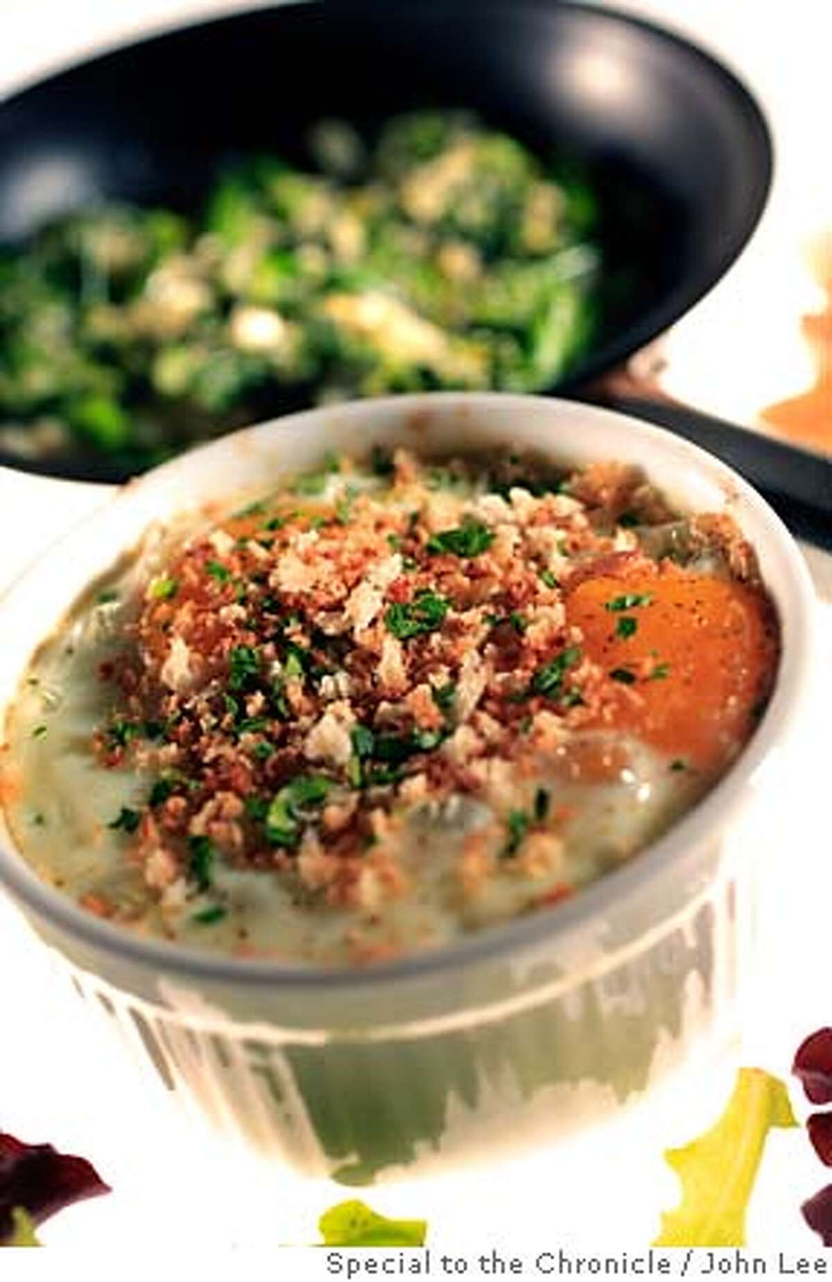 VEG21_SHIRRED_EGGS_02JOHNLEE.JPG Shirred Eggs with Greens and Gruyere. By JOHN LEE/SPECIAL TO THE CHRONICLE