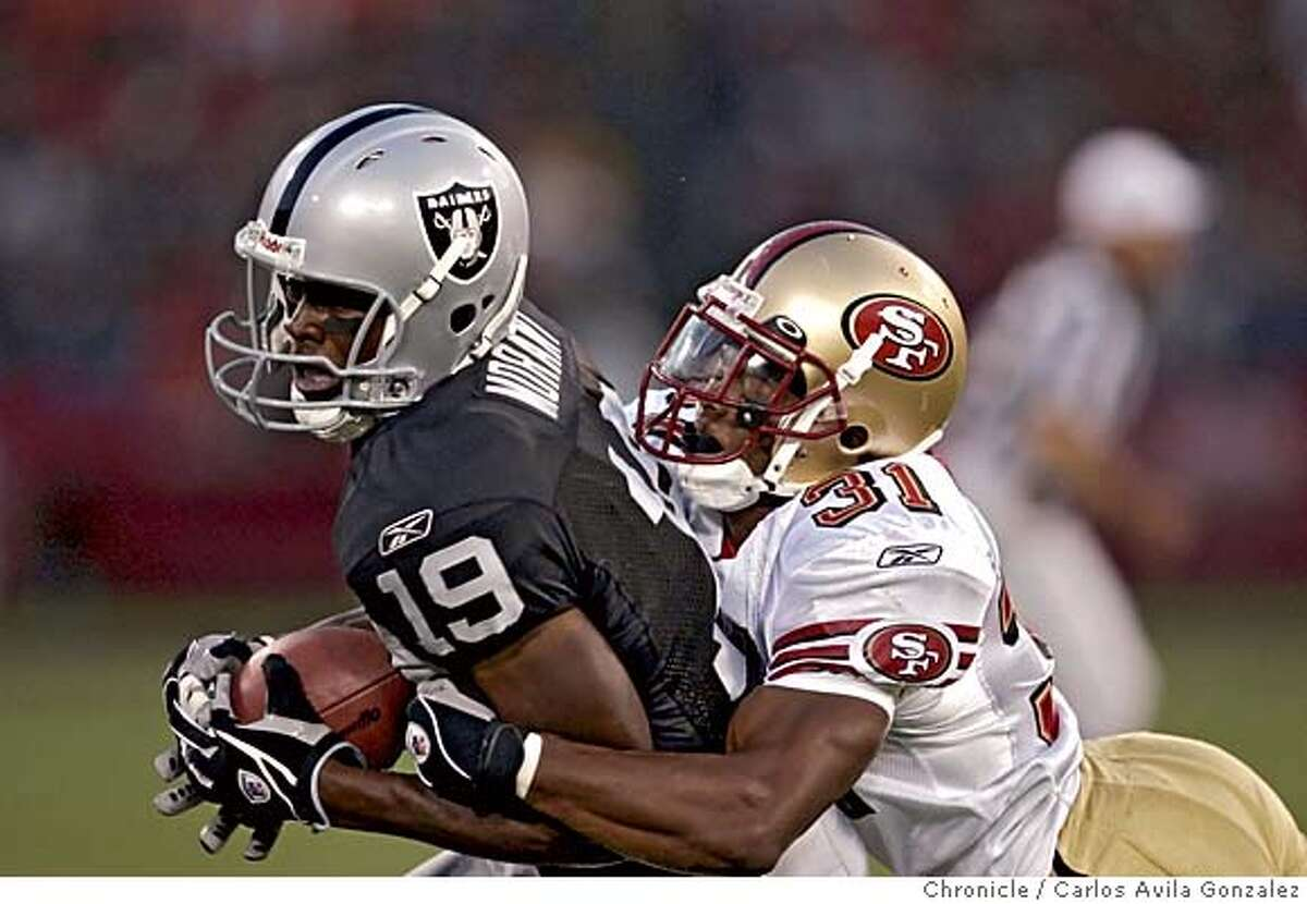 MORANT_002_CG.JPG The Oakland Raiders Johnnie Morant under pressure from 49ers cornerback, Rayshun Reed (31) during pre-season game action against the San Francisco 49ers at Monster Park in San Francisco, Ca., on Saturday, August 13, 2005. Photo by Carlos Avila Gonzalez / The San Francisco Chronicle Photo taken on 8/13/05, in San Francisco,CA.