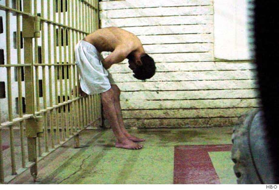 "This undated photo, released by HBO, shows a prisoner at the notorious Abu Ghraib prison. The documentary film by Rory Kennedy, ""Ghosts of Abu Ghraib,"" debuts on the premium channel Thursday, Feb. 22, 2007. (AP Photo/HBO) Photo: Ho"