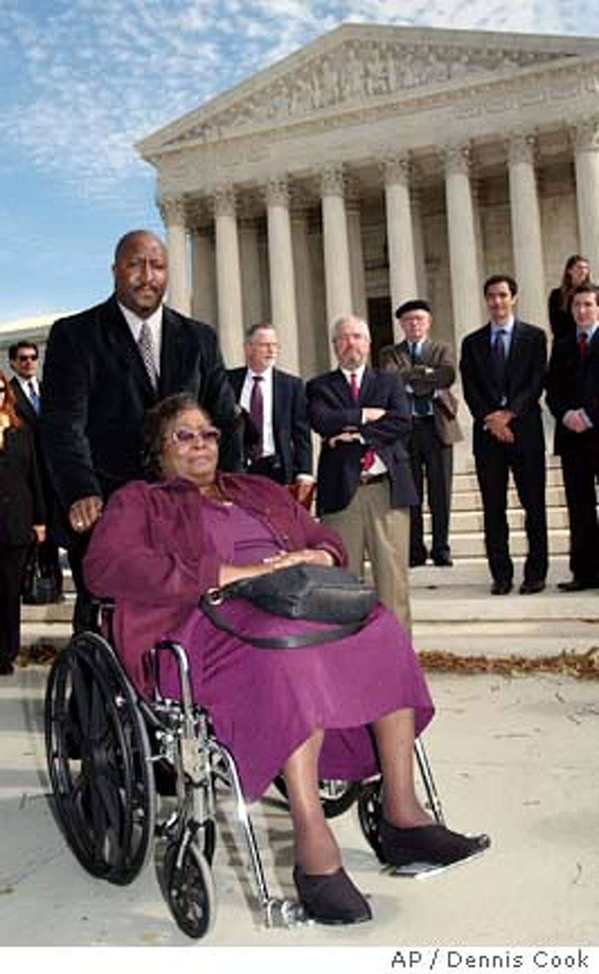 **FILE** Mayola Williams, in wheelchair, widow of Jesse Williams, who died of lung cancer, leaves the Supreme Court in Washington in this Oct. 31, 2006 file photo, following oral arguments in her lawsuit against Philip Morris. The Supreme Court threw out a $79.5 million punitive damages award to Williams, Tuesday, Feb. 20, 2007, a boon to businesses seeking stricter limits on big-dollar jury verdicts. (AP Photo/Dennis Cook, file)