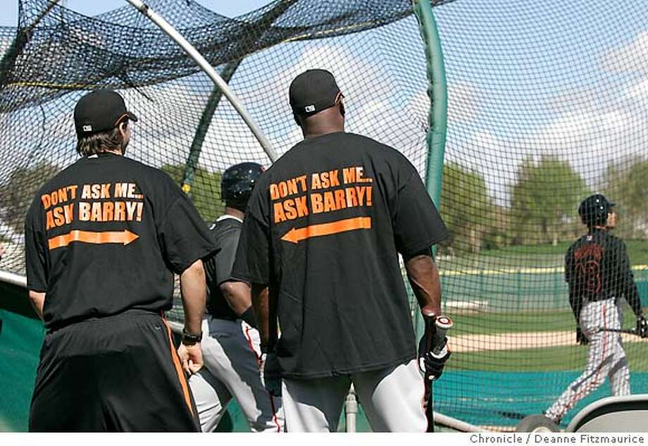 Barry Bonds has t-shirts made for himself and Barry Zito (left). They came out of the dugout and showed them off to the media. Barry Bonds arrives at spring training on the day the position players arrive for the first workout. San Francisco Giants have a spring training workout at Scottsdale Stadium. Photographed in Scottsdale on 2/20/07. Chronicle Photo / Deanne Fitzmaurice Photo: Deanne Fitzmaurice