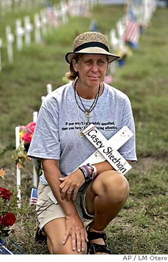 Cindy Sheehan poses for a magazine at her camp on the side of the road leading to President Bush's ranch near Crawford, Texas, Monday, Aug. 15, 2005. Sheehan's vigil to meet with President Bush is entering its' second week. Shehanwhose son CAsey died in Iraq said she will continue her anti-war demonstration for three more wee. (AP Photo/LM Otero) Photo: LM OTERO