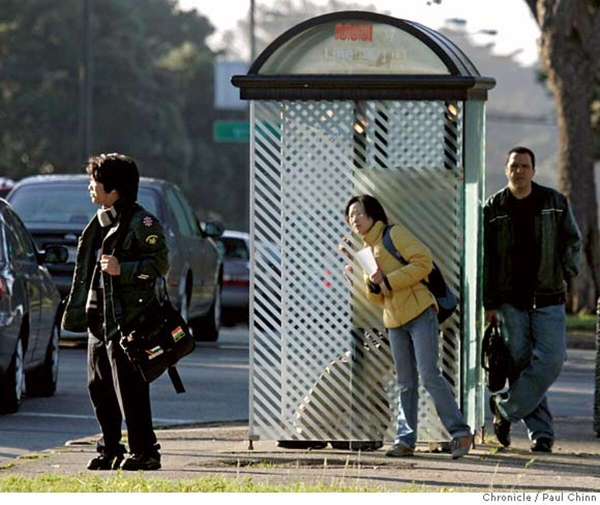 Passengers wait for a 29-Sunset Muni bus to show up at Sunset Boulevard and Taraval in San Francisco, Calif. on Wednesday, February 14, 2007. Statistics show that the 29-Sunset line has the worst on-time performance record running at 59 percent compared to the 1-California line which is on-time 82 percent of the time. PAUL CHINN/The Chronicle MANDATORY CREDIT FOR PHOTOGRAPHER AND S.F. CHRONICLE/NO SALES - MAGS OUT