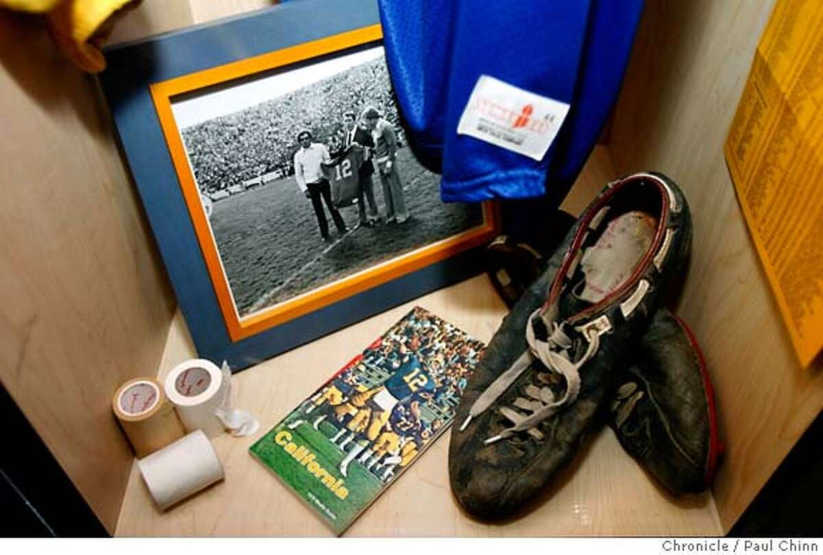 Memorabilia is included in Cal quarterback Joe Roth's locker, encased behind plexiglas, at Memorial Stadium in Berkeley, Calif. on Wednesday, February 14, 2007. The star quarterback died of cancer three months after his final game for the Bears 30 years ago. PAUL CHINN/The Chronicle **Joe Roth MANDATORY CREDIT FOR PHOTOGRAPHER AND S.F. CHRONICLE/NO SALES - MAGS OUT