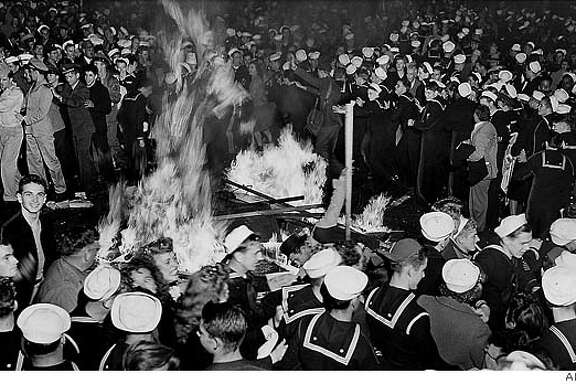 "Crowds celebrated around a bonfire in the middle of San Francisco's Market Street in the early morning hours of Aug. 14, 1945, after newspaper headlines proclaimed ""Tokyo Radio Says Japs Quit."" Sidewalk war bond booths provided fuel for the fire. Associated Press"