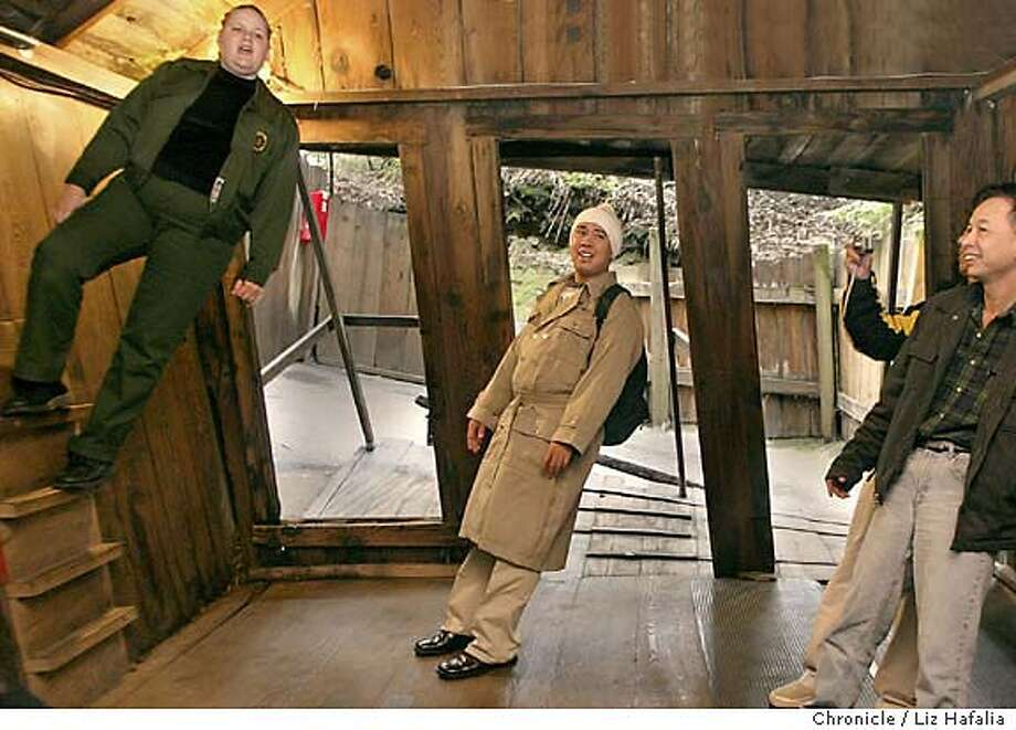 Guide Amber Bowyer (left) gives a tour of the Mystery Spot. Gerry Leoncio (middle) feeling like he's standing straight. (PHOTOGRAPHED BY LIZ HAFALIA/THE SAN FRANCISCO CHRONICLE) Photo: LIZ HAFALIA