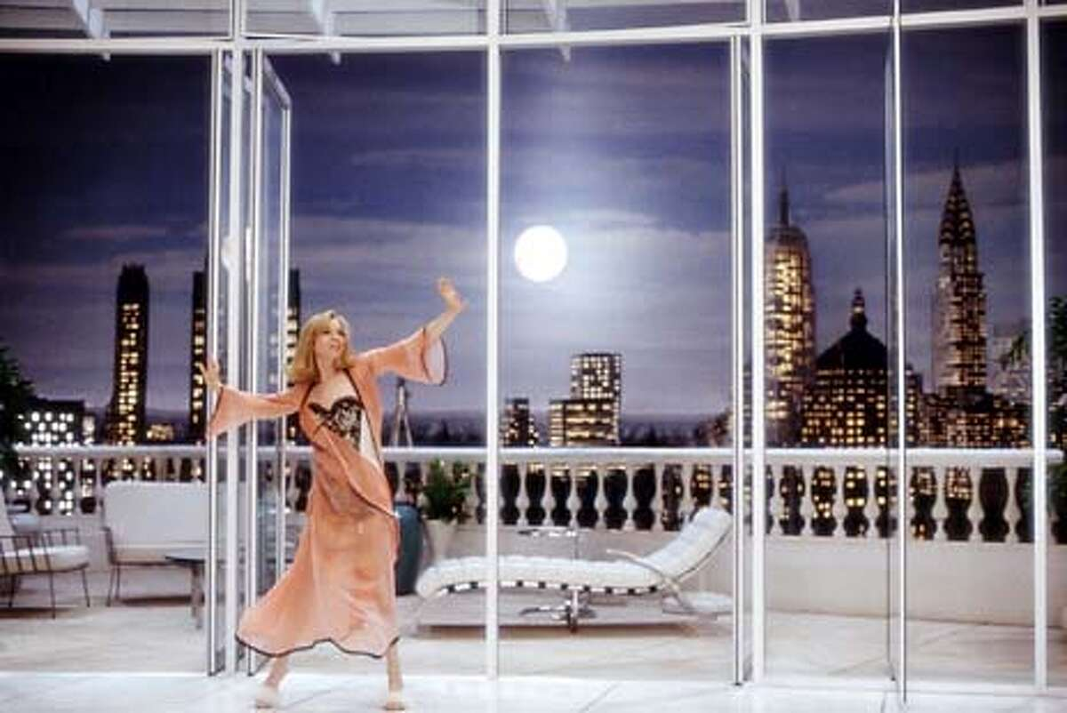 Actress Renee Zellweger is shown against a striking 120-degree panoramic view from her deluxe New York apartment, in a scene from her new film
