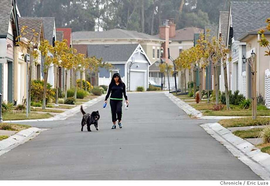 .JPG  Melanie Ebojo takes Patrick out for a walk through the Hercules development. The housing retail concept in this housing development with its Promenade district which has hopes of a cafe coming soon but for now is mostly real estate offices. Photographer:  Eric Luse / The Chronicle names cq from source MANDATORY CREDIT FOR PHOTOG AND SF CHRONICLE/NO SALES-MAGS OUT Photo: Eric Luse
