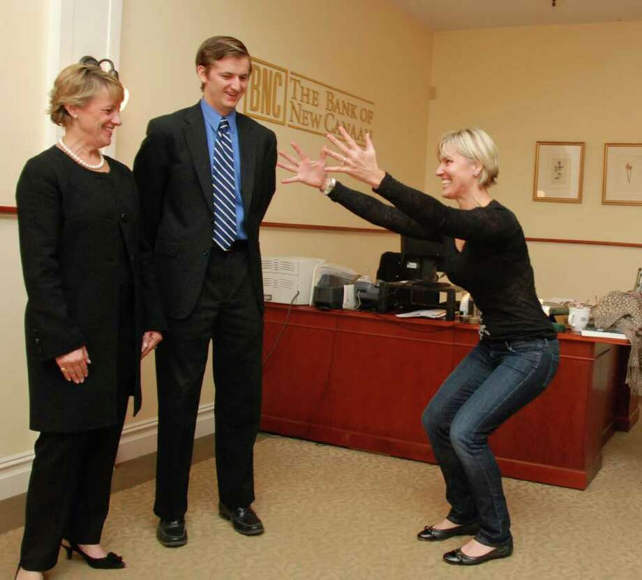 Julie Pryor demonstrates a move to Gail Donovan and David Klenk of The Bank of New Canaan. Photo: Contributed Photo