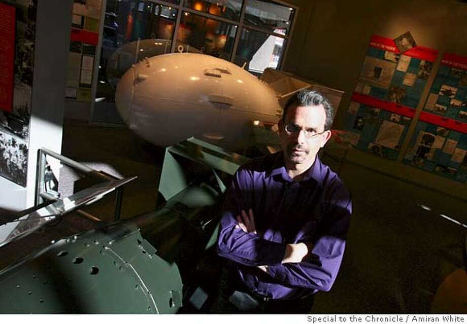 Dr. Joseph Martz, senior weapons scientist at the Los Alamos National Laboratory, stands with the Fat Man bomb in the background and next to The Little Boy, at the Bradbury Science Museum in Los Alamos, Monday February 5, 2007.  By Amiran White/SPECIAL TO THE CHRONICLE Photo: Amiran White