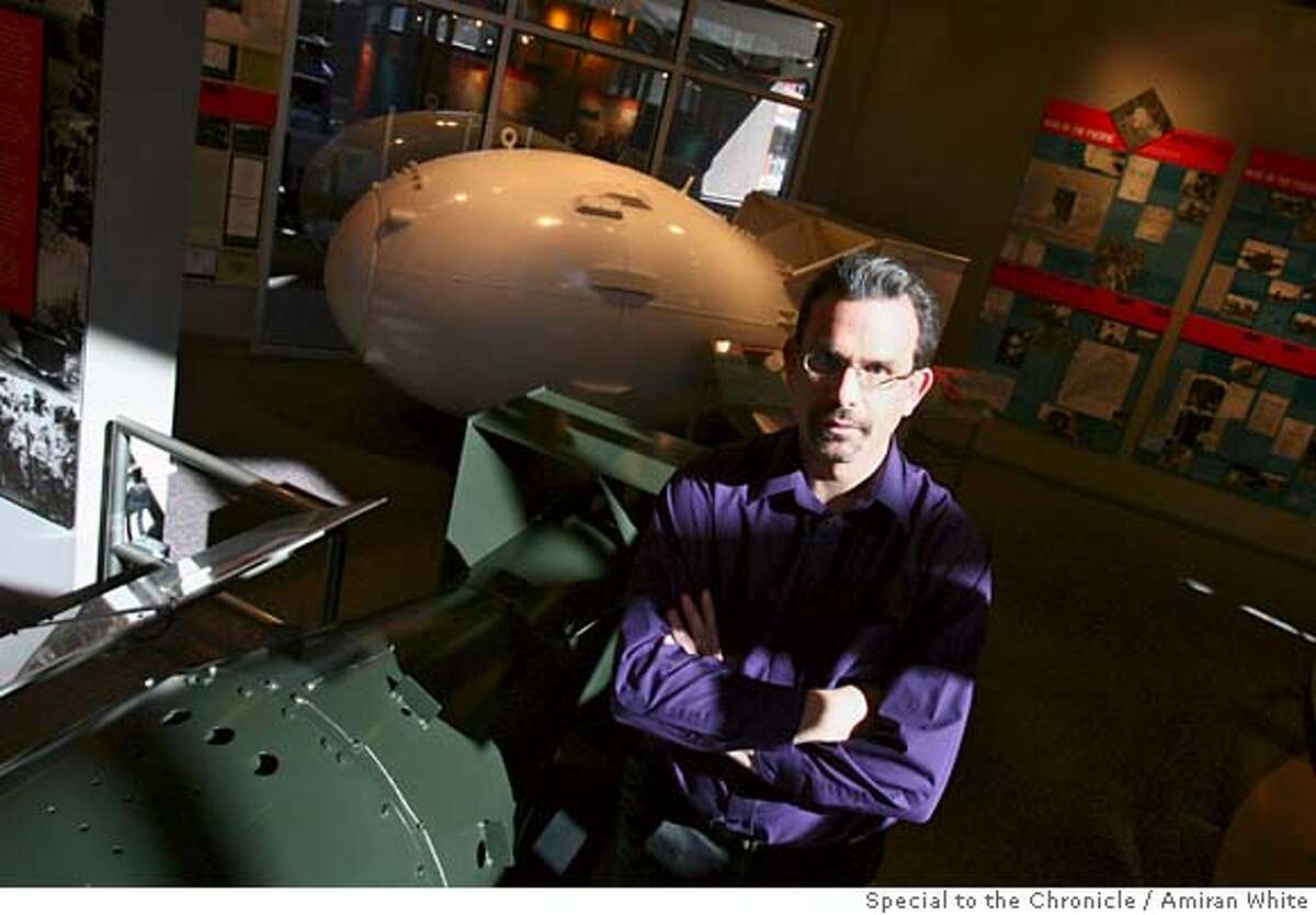 Dr. Joseph Martz, senior weapons scientist at the Los Alamos National Laboratory, stands with the Fat Man bomb in the background and next to The Little Boy, at the Bradbury Science Museum in Los Alamos, Monday February 5, 2007. By Amiran White/SPECIAL TO THE CHRONICLE