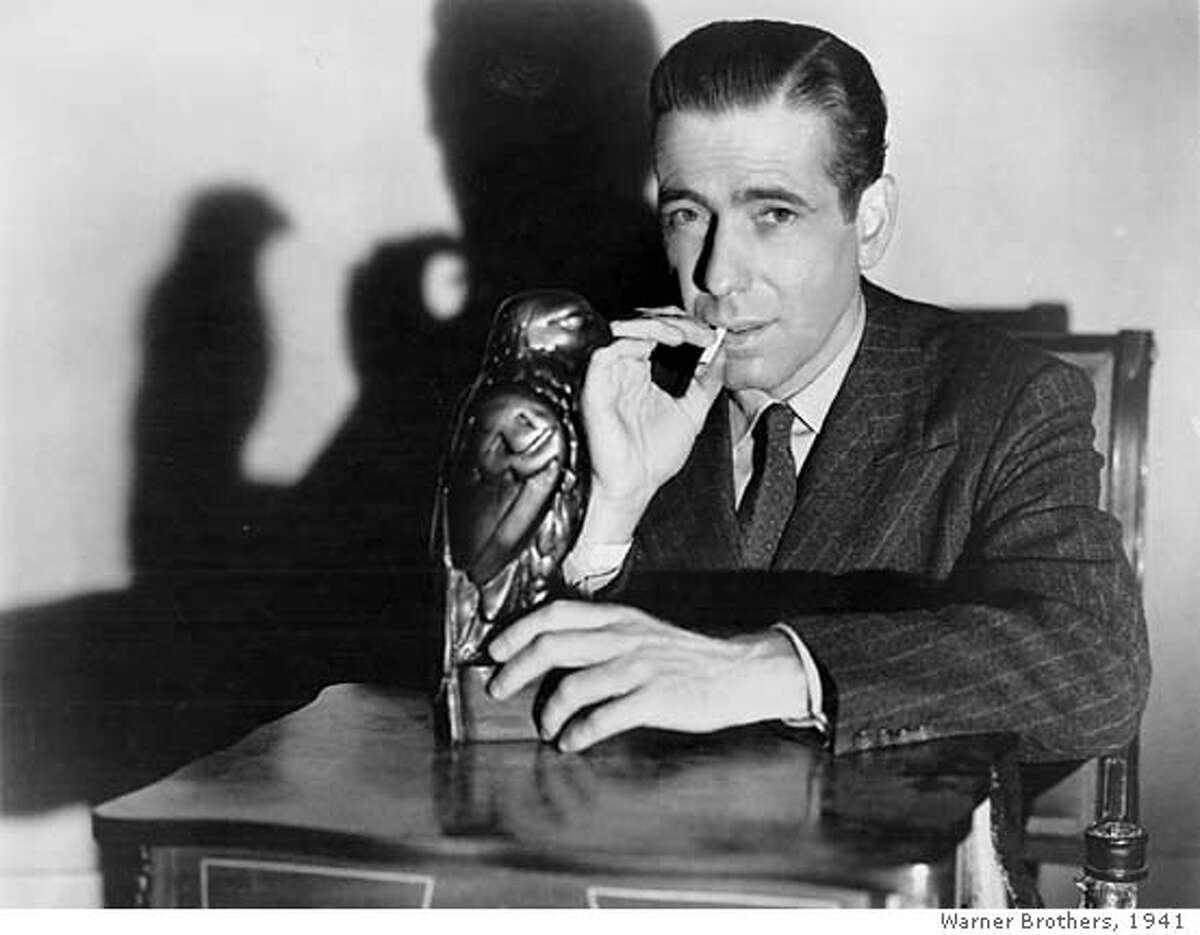 "BOGART/C/17DEC99/DD/HO-Humphrey Bogart starred in ""The Maltese Falcon."" HANDOUT ALSO RAN 3/13/02, 01/14/03, 12/6/03 Ran on: 02-07-2005 Humphrey Bogart, as Private Detective Sam Spade, poses with the object of desire in The Maltese Falcon. CAT"