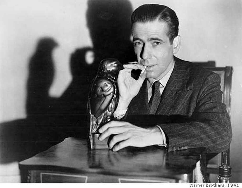 "BOGART/C/17DEC99/DD/HO-Humphrey Bogart starred in ""The Maltese Falcon.""  HANDOUT ALSO RAN 3/13/02, 01/14/03, 12/6/03 Ran on: 02-07-2005  Humphrey Bogart, as Private Detective Sam Spade, poses with the object of desire in &quo;The Maltese Falcon.'' CAT Photo: HANDOUT"