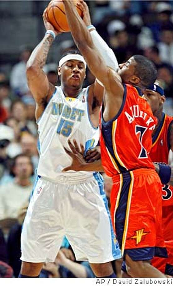 Denver Nuggets forward Carmelo Anthony, left, is trapped with the ball by Golden State Warriors guard Kelenna Azubuike, front right, and forward Al Harrington in the first quarter of an NBA basketball game in Denver on Monday, Feb. 12, 2007. (AP Photo/David Zalubowski) Photo: David Zalubowski