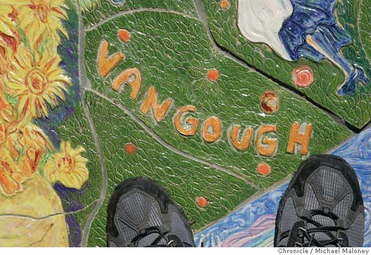 """MURAL009_MJM.jpg Van Gogh is misspelled with the """"u"""". A $40,000 ceramic mural unveiled outside Livermore's new library when it opened earlier this year will cost the city $6,000. because of the artist's misspelled names. Einstein, Shakespeare, Vincent Van Gogh, Michelangelo and seven other historical figures were misspelled. """"Our library director is very frustrated that she has this lovely new library and it has all these misspellings in front,"""" said city councilwoman Lorraine Dietrich, one of three council members who voted Monday to authorize paying another $6,000, plus expenses, to fly the artist up from Miami to fix the errors. Artist Maria Alquilar said she was willing to fix the brightly colored 16-foot-wide circular work, but offered no apologizes for the 11 misspellings among the 175 names. """"The importance of this work is that it is supposed to unite people,"""" Alquilar said. """"They are denigrating my work and the purpose of this work."""" Photo by Michael Maloney / San Francisco Chronicle Ran on: 10-11-2004 Mosaic at the Livermore Library misspells van Goghs and others names. MANDATORY CREDIT FOR PHOTOG AND SF CHRONICLE/ -MAGS OUT Metro#Metro#Chronicle#10/15/2004#ALL#5star##0422400033"""