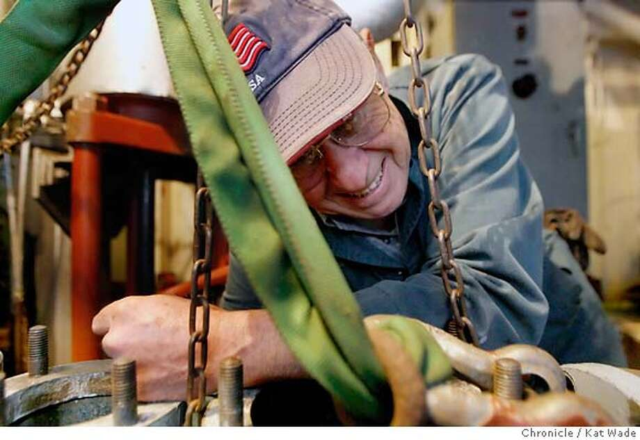 REDOAK07_0114_KW_.jpg  Red Oak Victory Volunteer Charles Miglia, a machinist mate works on replacing the fire pump manifold in the engine room with one they modified after taking it from a ship in the moth ball fleet in Benia while work on restoring the WWII Military cargo ship to sea worthiness on Tuesday February 6, 2007. The ship was built in 1944 in just three months by women in Richmond for cargo, including amunition  Kat Wade/The Chronicle Mandatory Credit for San Francisco Chronicle and photographer, Kat Wade, Mags out Photo: Kat Wade