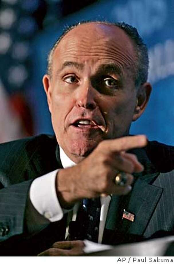 Former New York City Mayor Rudy Giuliani, who is considering seeking the Republican nomination for president, gestures as he speaks at the Churchill Club in Santa Clara, Calif., Monday, Feb. 12, 2007. (AP Photo/Paul Sakuma) Photo: PAUL SAKUMA