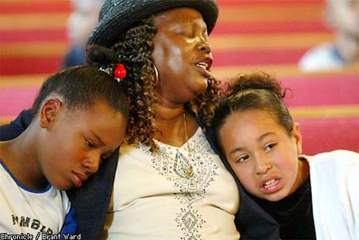The funeral for Julia Middleton--better known as Aunt Bea--was held Thursday at St. John Baptist Missionary Church on Third Street in San Francisco. Children and adults alike, whom she touched during her time in Hunters Point, turned out to remember and say goodbye. Here Naeshante Joshua, left, and Sandra Rodriguez sought comfort in the arms of their choir teacher Tessa (no last name given) as they were caught up in the emotion of their beloved Aunt Bea's memorial. BRANT WARD / The Chronicle