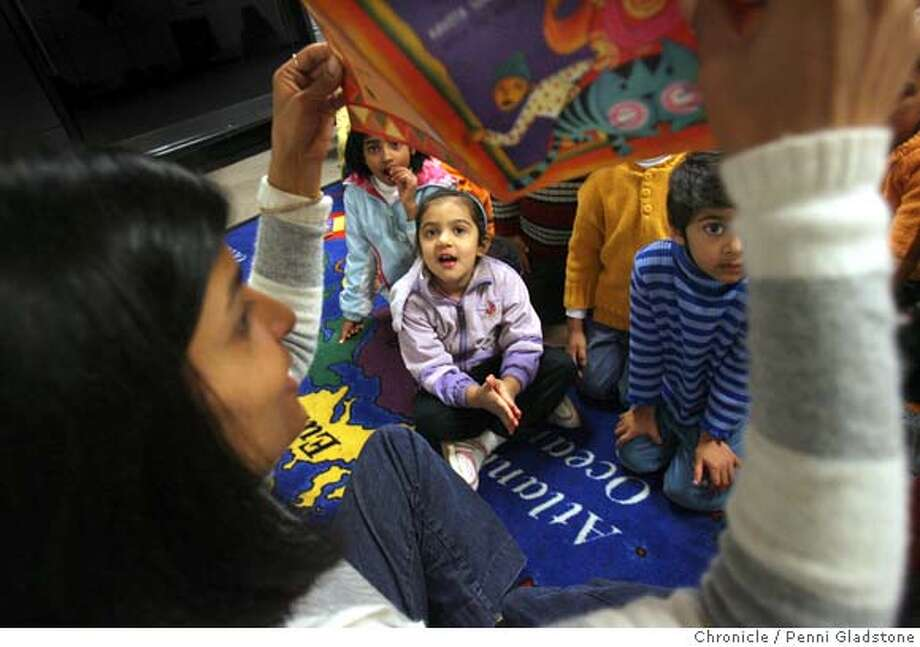 INDIABOOK  Monica Khosla reads a book and shows it's pictures to the kids during storytime at the Indian Community Center. At right in blue strips is Aashne Gajaria, in purple at left is Suhani Arora.  Event on 1/31/07 in Milpitas.  Penni Gladstone / The Chronicle Ran on: 02-12-2007  Monica Khosla shows a book to kids during story time at the Indian Community Center in Milpitas.  Ran on: 02-12-2007  Monica Khosla shows a book to kids during story time at the Indian Community Center in Milpitas. Photo: Penni Gladstone