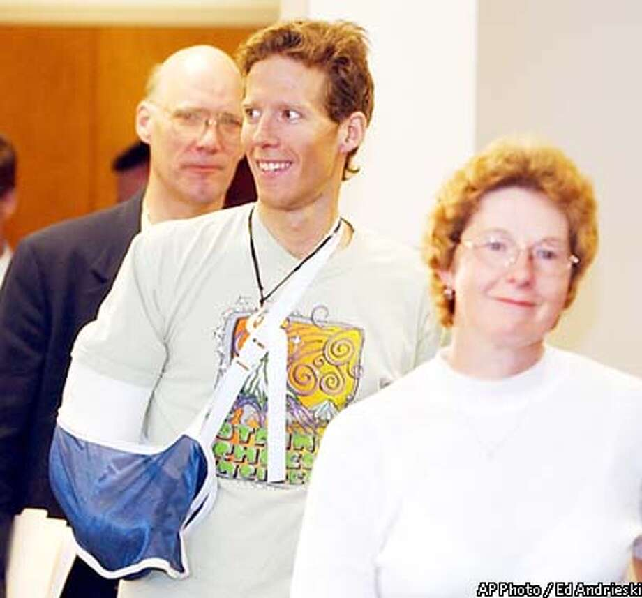 Climber Aron Ralston, center, is accompanied by his father Larry and mother Donna as he arrives for a news conference at St. Mary's Hospital in Grand Junction, Colo., on Thursday, May 8, 2003. Ralston cut off his right arm to save his life while climbing in Canyonlands National Park in Utah last week. (AP Photo / Ed Andrieski) Photo: ED ANDRIESKI