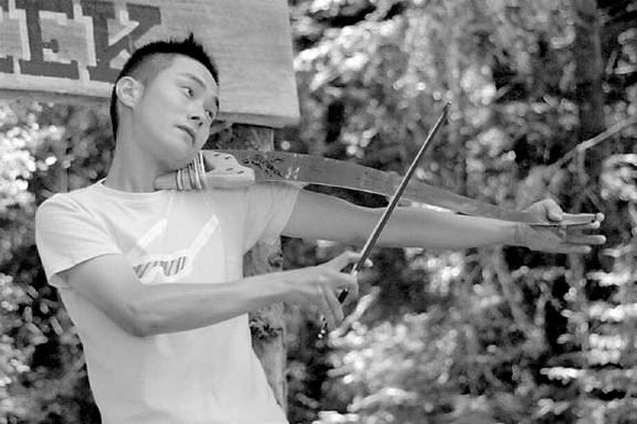 Musical Saw Festival  Hajime Sakita playing the saw as a violin  HO