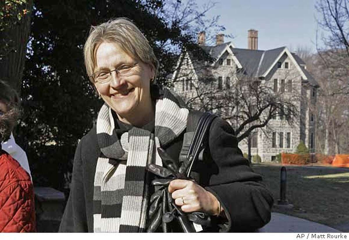 Drew Gilpin Faust is seen walking at Bryn Mawr College in Bryn Mawr, Pa., Friday, Feb. 9, 2007. Harvard University could be about to name its first female president, as the governing board charged with vetting candidates has narrowed its search to a single one, historian Drew Gilpin Faust, according to published reports. (AP Photo/Matt Rourke)