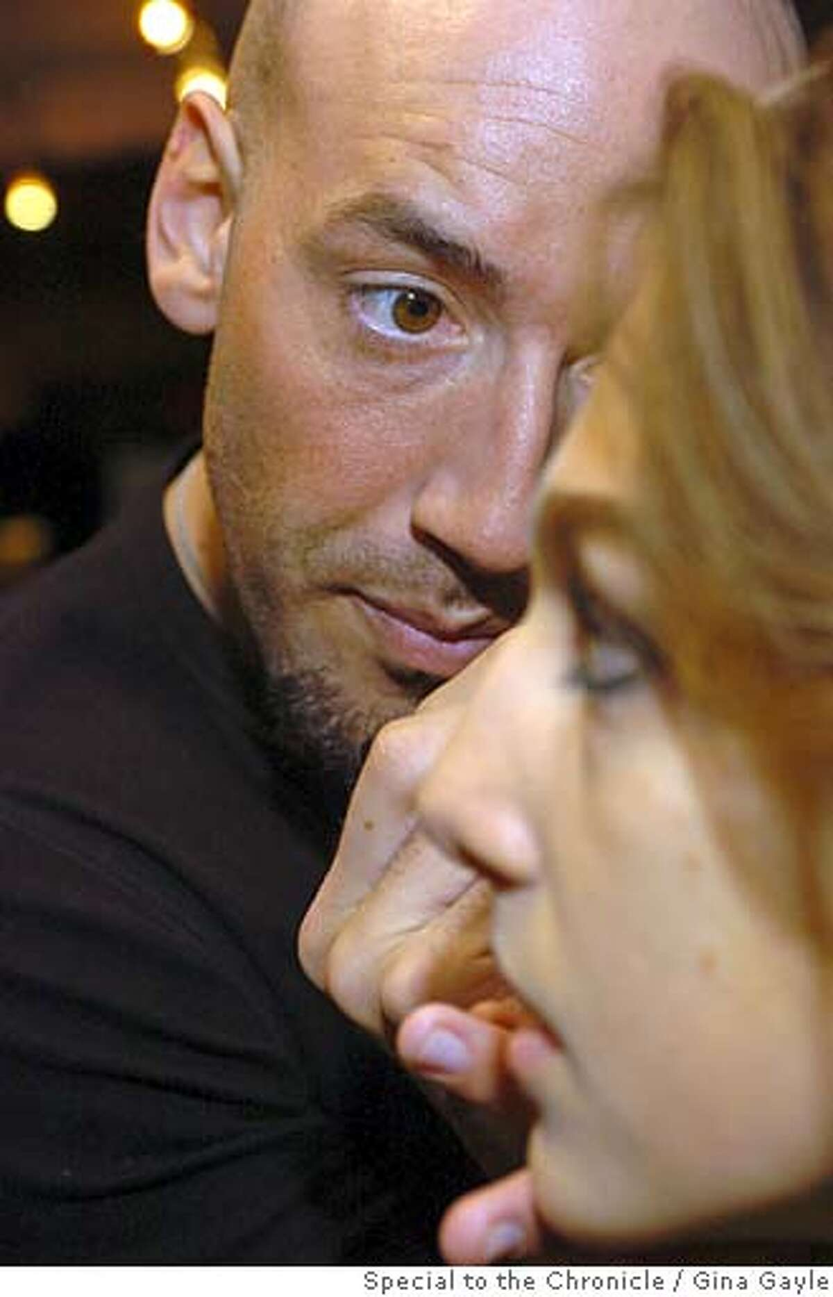 San Francisco based MAC makeup artist Victor Cembellin does makeup on model Bruna Sottili of Brazil for the Three as Four Fashion Show at the National Arts Club in Manhattan for New York Fashion Week 2007 on February, 3, 2007. (photo by Gina Gayle).