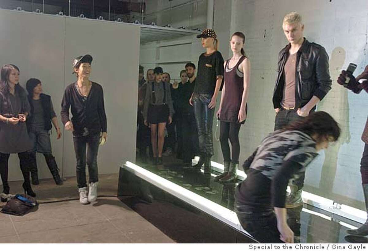 Designer Alexander Wang (walking, center) checks the lineup during practice before he shows his Fall 2007 line for New York Fashion Week at a refurbished factory in New York on Saturday, February 3, 2007. (photo by Gina Gayle).
