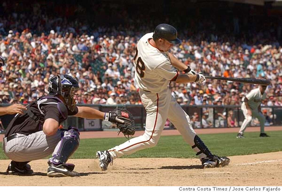 San Francisco Giants Lance Niekro, #28, connects for a double scoring teammates Pedro Feliz, #7, and Ray Durham, #5, in the 8th inning of their game against the Colorado Rockies on Thursday, August 4, 2005 at SBC Park in San Francisco, Calif. The Giants beat the Rockies 6-4.(Jose Carlos Fajardo/Contra Costa Times)
