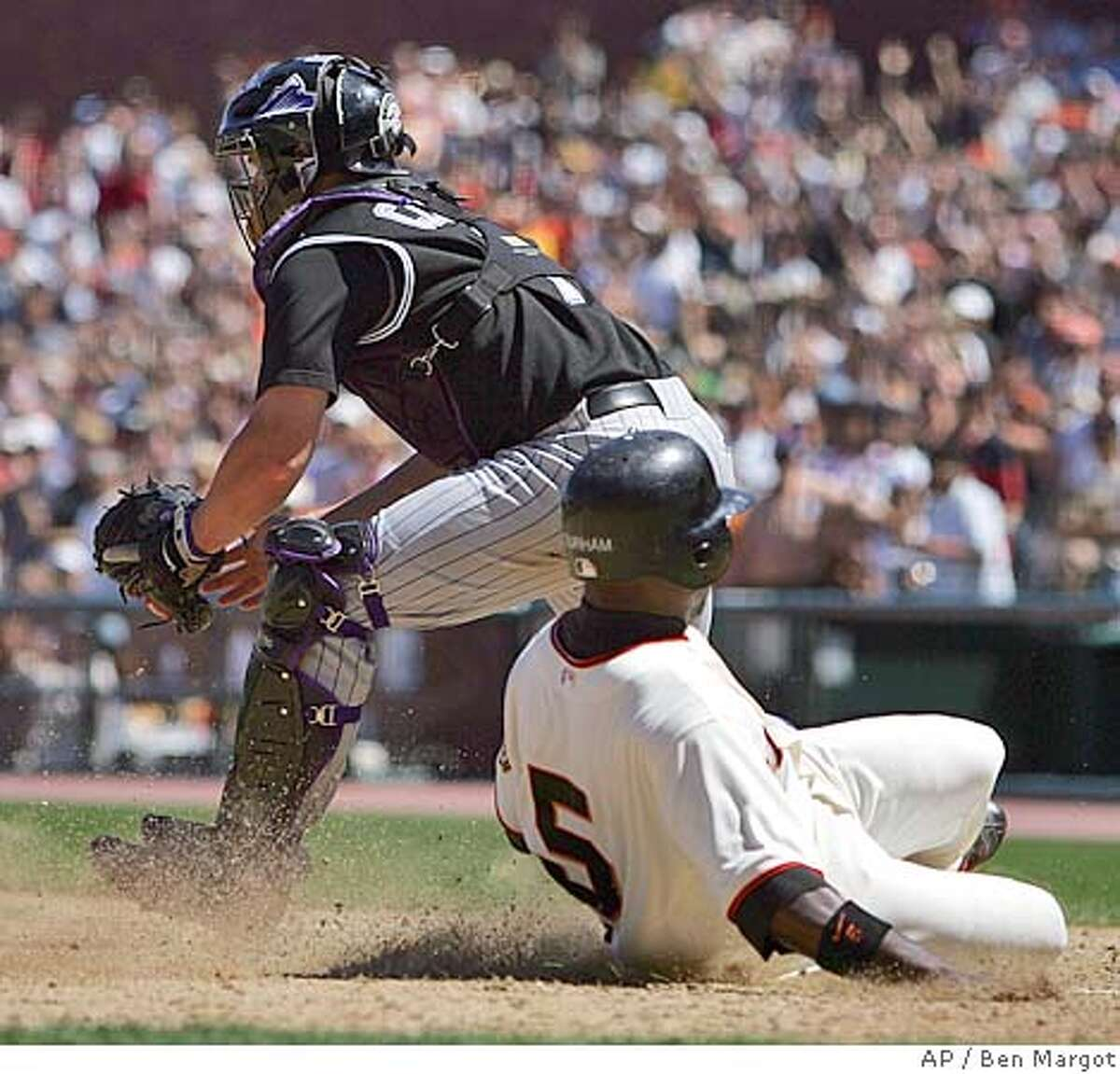 San Francisco Giants' Ray Durham scores behind Colorado Rockies' catcher J.D. Closser in the eighth inning Thursday, Aug. 4, 2005, in San Francisco. San Francisco won the game, 6-4. (AP Photo/Ben Margot)
