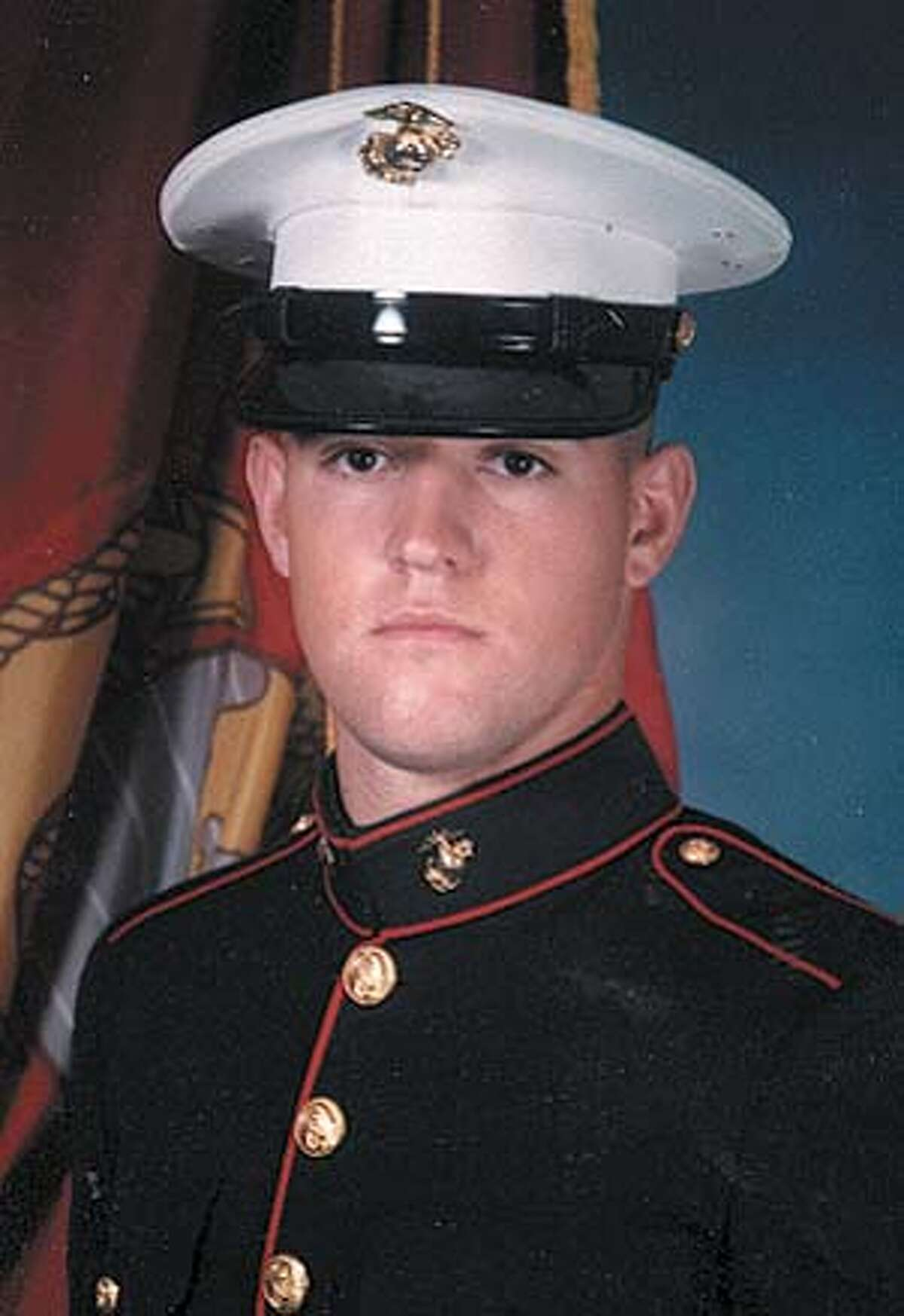 Photo of U.S. Marine Adam Strain. Credit: AP