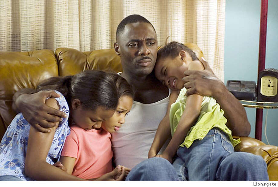 "Sierra McClain, Lauryn McClain and China Anne McClain with Idris Elba in ""Daddy's Little Girl"" Photo: Lionsgate"