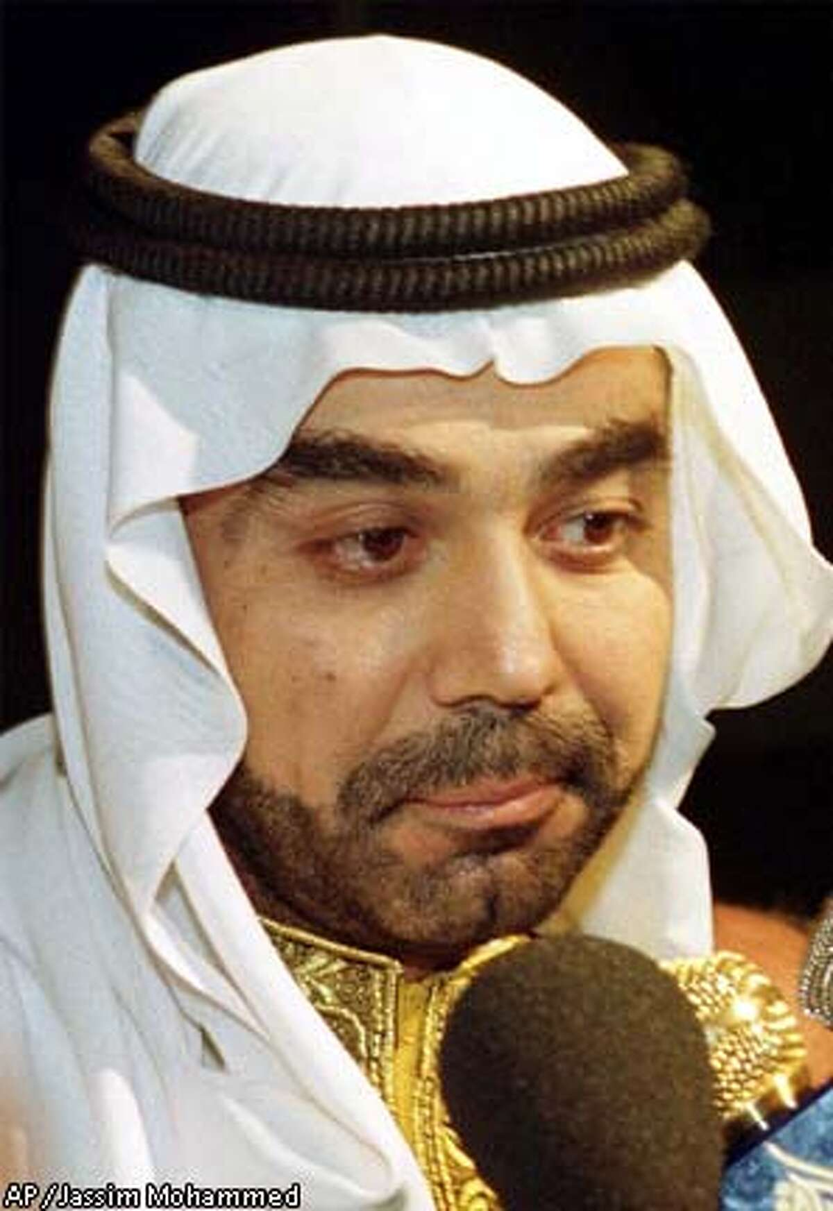 ** FILE** Odai, eldest son of Iraqi President Saddam Hussein, is seen in Baghdad on Monday, March 27, 2000. The IOC wants Iraq's Olympic committee replaced by a group with no links to torture and other abuses that took place under Saddam Hussein. The IOC's ethics commission made the recommendations after investigating accusations that the Iraqi committee, led by Saddam's son Odai, brutalized and jailed athletes.(AP Photo/Jassim Mohammed)