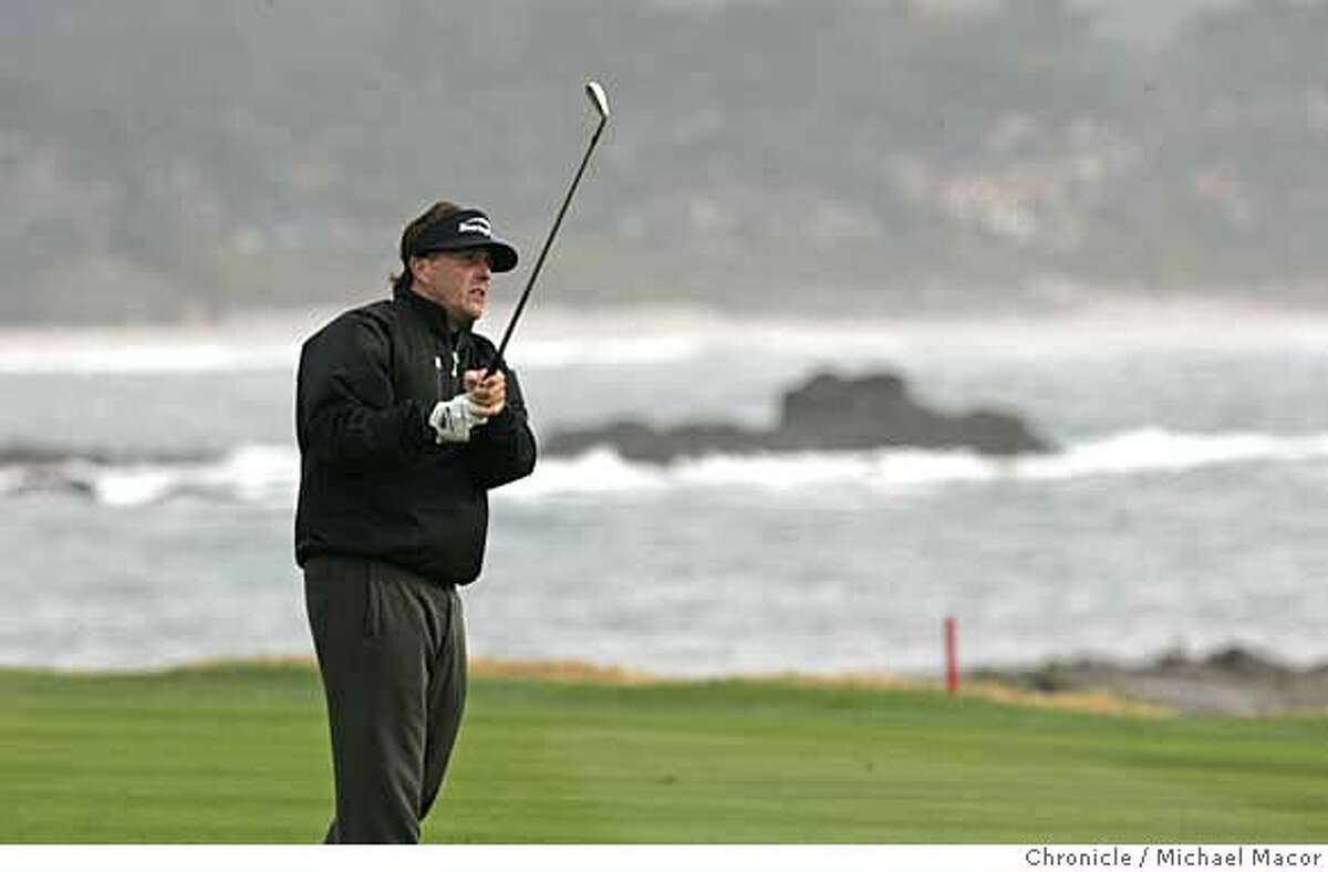 Phil Mickelson with his approach shot to his final hole, #18 at Pebble Beach, which he birdied to get to 12 under tied for the lead with Jim Furyk. Round 2 of the AT&T Pebble Beach National Pro Am Photographed in, Monterey, Ca, on 2/9/07. Photo by: Michael Macor/ San Francisco Chronicle
