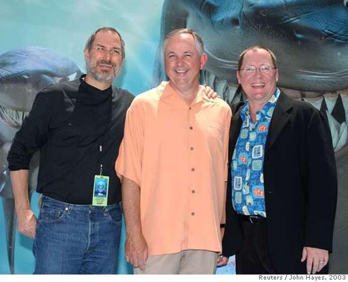 Apple Computer CEO and Pixar chief Steve Jobs (L-R), Dick Cook Chairman, Walt Disney Studios, and