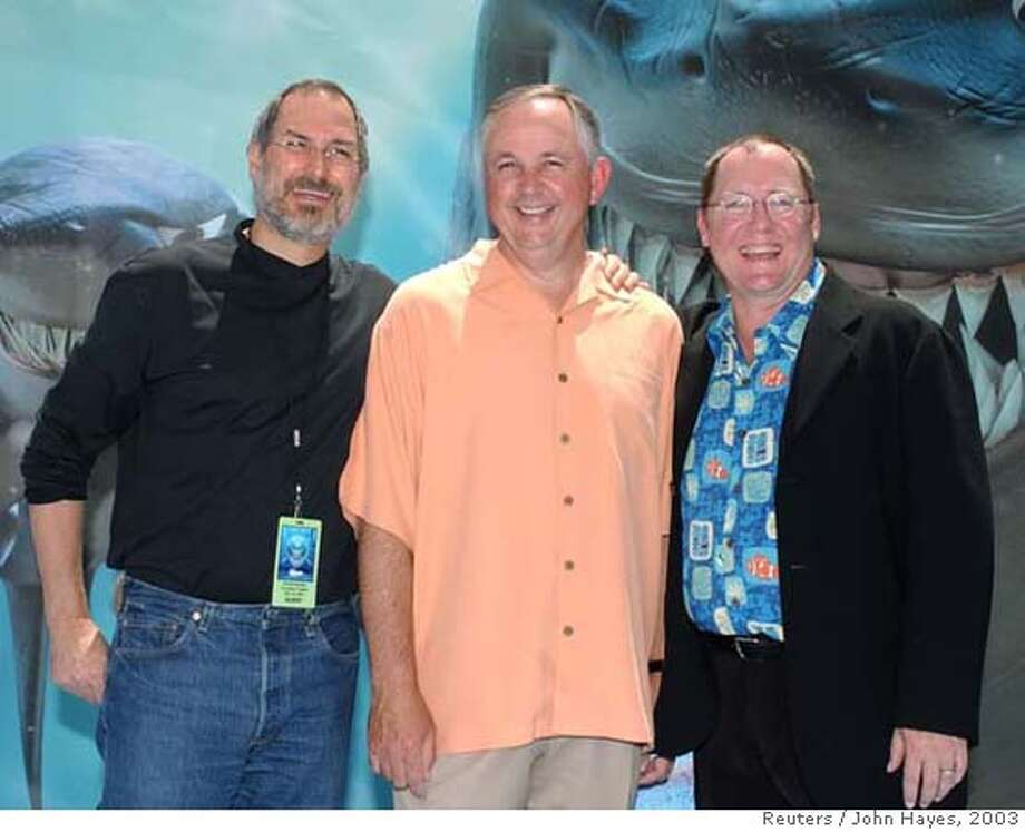 """Apple Computer CEO and Pixar chief Steve Jobs (L-R), Dick Cook Chairman, Walt Disney Studios, and """"Finding Nemo"""" executive producer John Lasseter arrive to the world premiere of the film May 18, 2003, in Los Angeles. Pixar and Disney plan on working out a deal that will change the terms of their current partnership. REUTERS/John Hayes RESEND: NEW PAGE NO. Mug of John Lasseter, guy on the right. Photo: JOHN HAYES"""