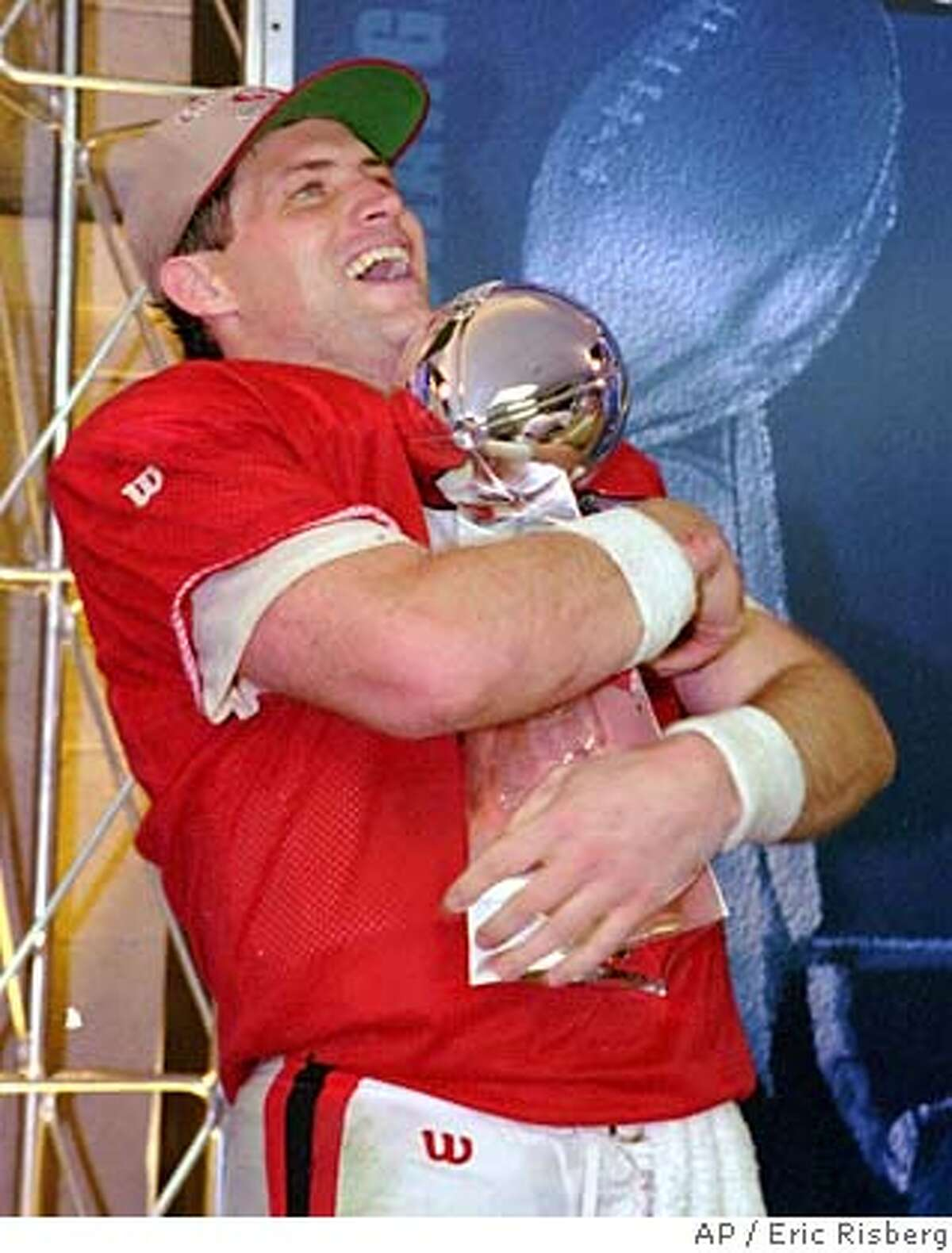 ** FILE ** San Francisco 49ers quarterback Steve Young hugs the Lombardi trophy after beating the San Diego Chargers 49-26 in Super Bowl XXIX at Miami's Joe Robbie Stadium, in this Jan. 29, 1995 photo. (AP Photo/Eric Risberg)