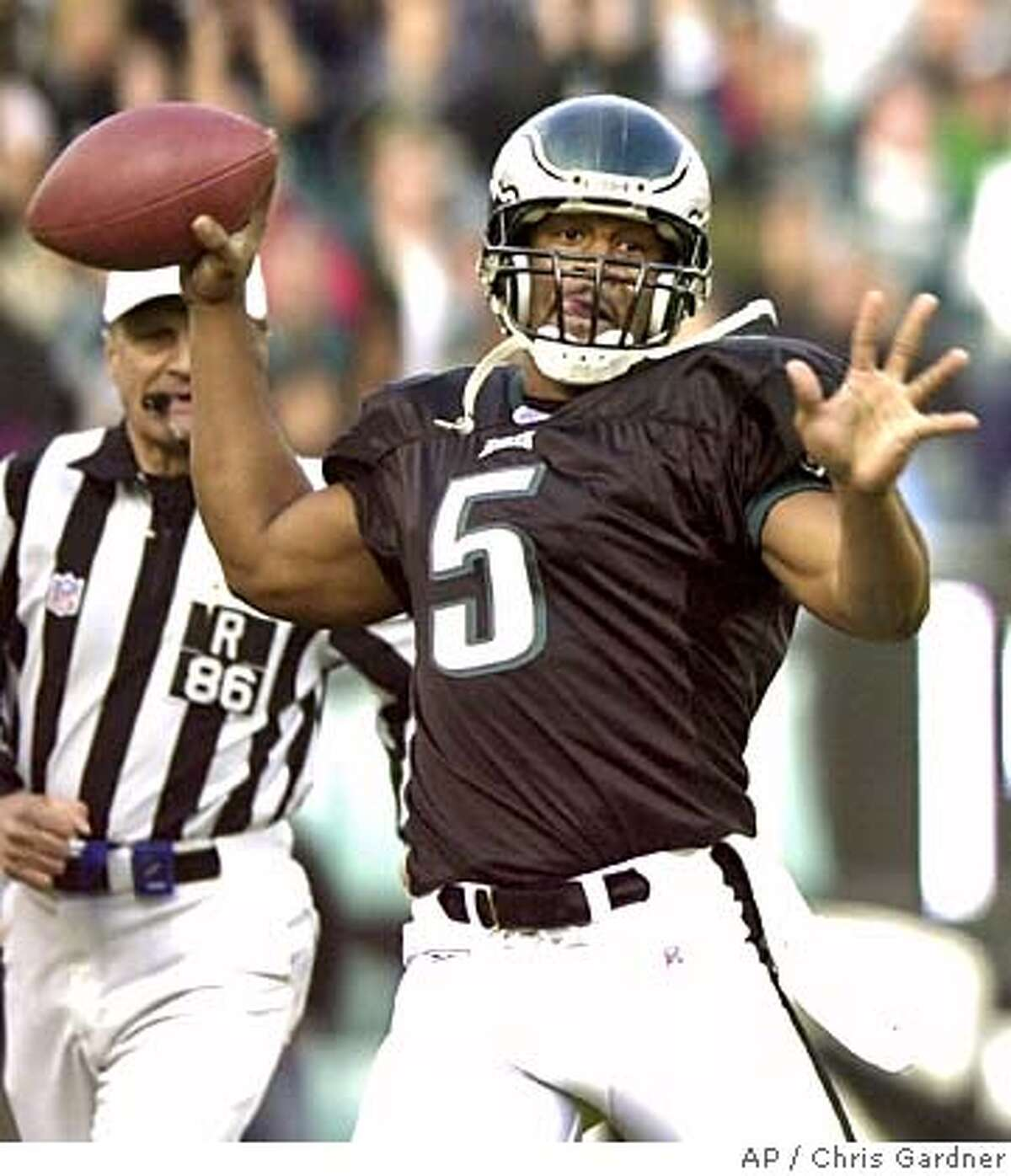 Philadelphia Eagles quarterback Donovan McNabb throws a pass to wide reciever Freddy Mitchell during the second quarter against the New York Giants, Sunday, Nov. 16, 2003, in Philadelphia. The Eagles won 28-10. (AP Photo/Chris Gardner) Photo caption 1068854400APPhiladelphia Eagles quarterback Donovan McNabb throws a pass to wide reciever Freddy Mitchell during the second quarter against the New York Giants, Sunday, Nov. 16, 2003, in Philadelphia. The Eagles won 28-10. (AP Photo-Chris Gardner) Photo caption 1068854400APPhiladelphia Eagles quarterback Donovan McNabb throws a pass to wide reciever Freddy Mitchell during the second quarter against the New York Giants, Sunday, Nov. 16, 2003, in Philadelphia. The Eagles won 28-10. (AP Photo-Chris Gardner)