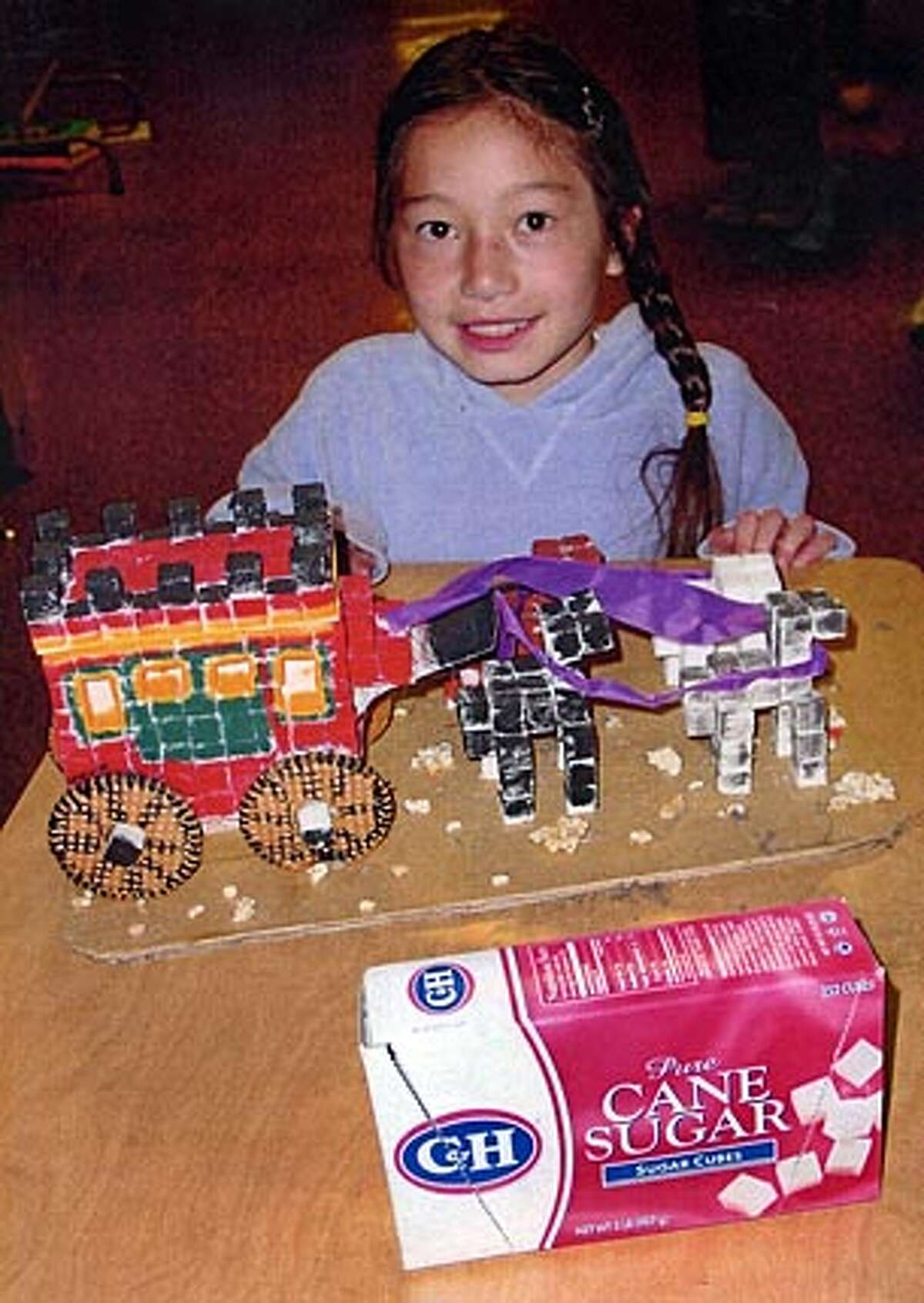 """Marie Weverka, SugArt Grand Prize Winner, Most Original Entry� from Sherman School in San Francisco, with�her sugar-cube """"Stagecoach."""""""