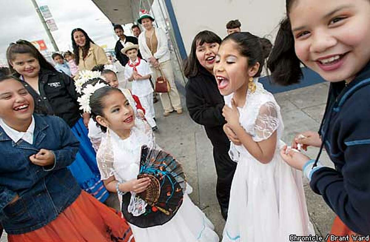 The annual Cinco de Mayo parade was held on Sunday on International Blvd. Sunday in Oakland. Hundreds lined the street for the popular parade. Crystal Santiago, center white dress, let out a scream as they announced her West Oakland school was about to begin marching. BRANT WARD / The Chronicle