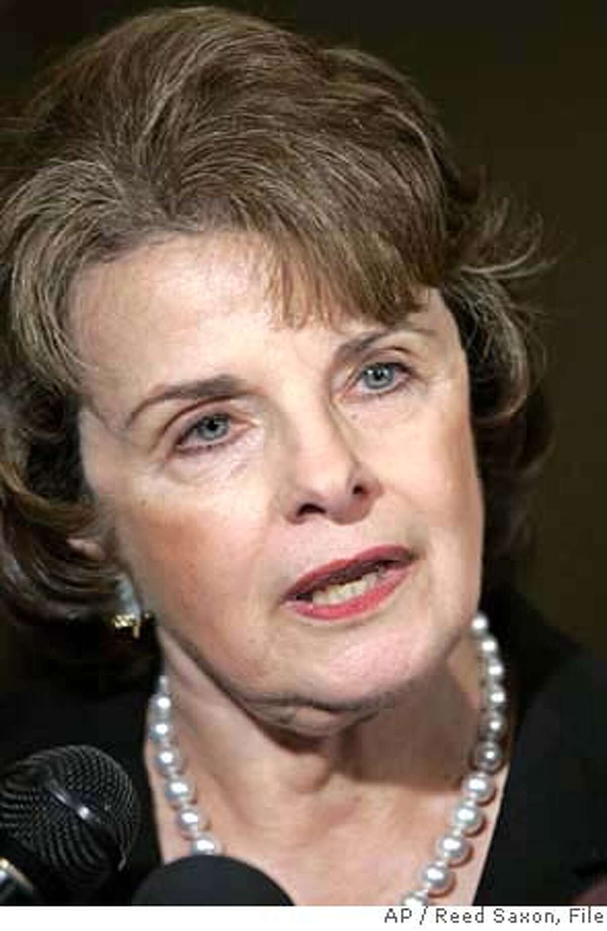 ** FILE ** U.S. Sen. Dianne Feinstein, D-Calif., talks with reporters in Los Angeles in this Wednesday, Oct. 25, 2006 file photo. Feinstein is cautioning Republicans against blocking a vote Monday, Feb. 5, 2007 on a resolution opposing President Bush's troop increase in Iraq, saying it would be a