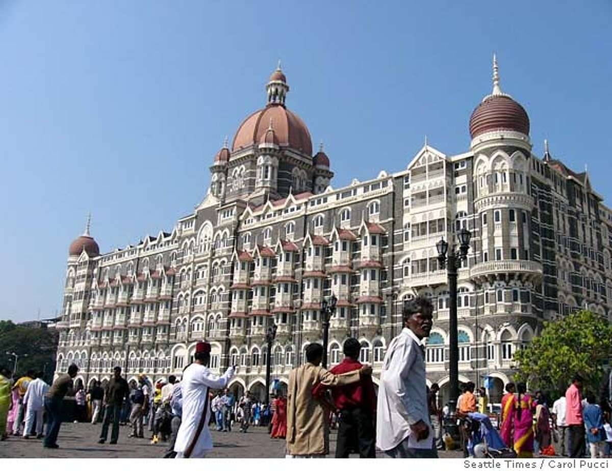 The Taj Mahal Palace hotel, built in 1903, is a landmark in Mumbai, India. (Carol Pucci/Seattle Times/MCT) Ran on: 11-19-2006 Mumbai streets: The landmark Taj Mahal Palace hotel, left, was built in 1903. A street vendor, above, makes paan, a digestive made from Betel leaves packed with lime paste and spices. Ran on: 11-19-2006 NC WEB BL NO MAGAZINE SALES