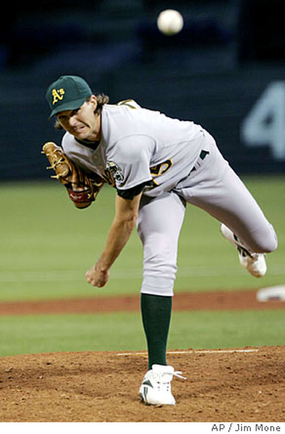 Oakland Athletics pitcher Barry Zito throws in the fouth inning on his way to picking up his 11th win as the Athletics beat the Twins 5-2 Thursday, Aug. 4, 2005 in Minneapolis. Zito gave up two runs on four hits in his eight inning appearance. (AP Photo/Jim Mone)