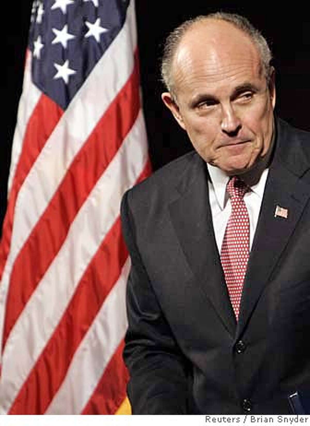 Former New York City Mayor and possible Presidential candidate Rudolph Giuliani steps away from the podium after speaking at the New Hampshire Republican convention in Manchester, New Hampshire January 27, 2007. REUTERS/Brian Snyder (UNITED STATES) Ran on: 01-28-2007 Rudolph Giuliani steps away from the podium after speaking at the New Hampshire Republican convention in Manchester.