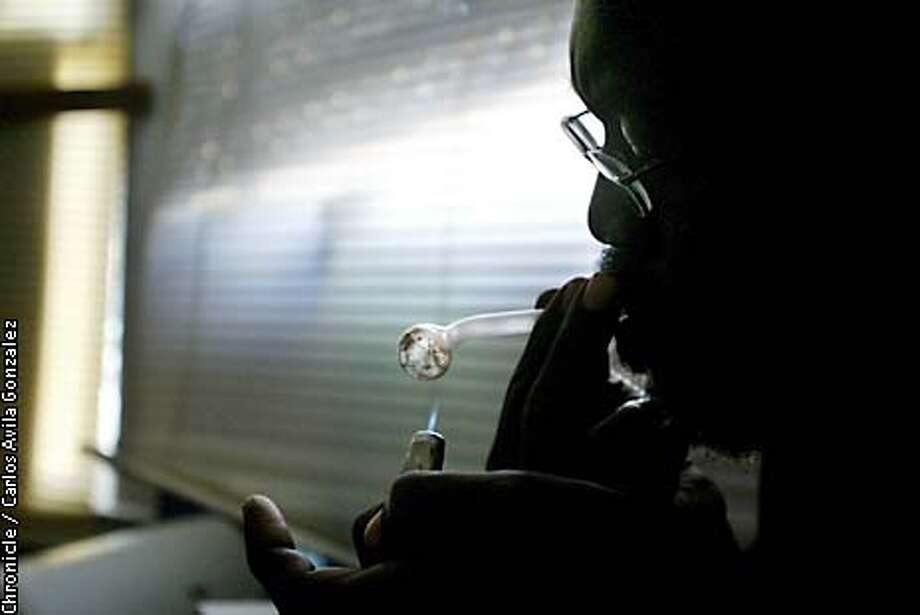 """Isaac"" puts a lighter on the pipe he uses to smoke his crystal methamphetamine as he smokes a small amount in his apartment on Monday, April 21, 2003. (CARLOS AVILA GONZALEZ/SAN FRANCISCO CHRONICLE) Photo: CARLOS AVILA GONZALEZ"
